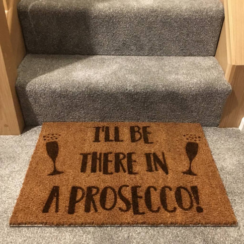 'I'll Be There in a Prosecco' Doormat